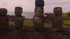 Group of restored moai at Tongariki, Easter Island, in the afternoon sunshine Stock Footage