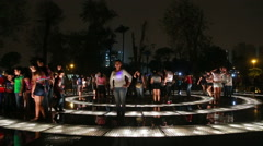 People having fun ang getting wet at the park with a fountain in Lima, Peru. Stock Footage