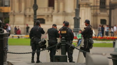 Police back with asault fusil in Lima, Peru Stock Footage