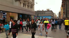 Unidentified people walking down the street in Lima, Peru Stock Footage