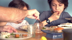Father and daughter fighting over meatball at the dinner table Stock Footage
