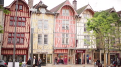 Modern shops in medieval half-timbered buildings, Troyes, France Stock Footage
