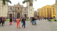 People walking by and relaxing at the main square in Lima Stock Footage