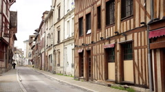 Half-timbered buildings along narrow street Stock Footage