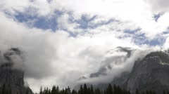 Time lapse of clouds swirling around mountains in Yosemite National Park - stock footage
