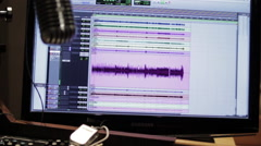 Sound waves on a computer monitor in a recording studio Stock Footage