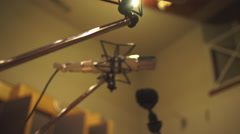 Large-diapragm condenser microphone in a recording studio Stock Footage