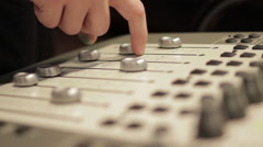 Sound engineer adjusting levels on audio mixer, close-up - stock footage