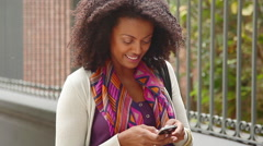 Woman text messaging while on the move - stock footage