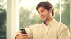 Man sending text message and talking on cell phone Stock Footage