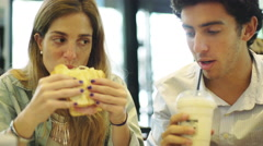 Couple dining at fast food restaurant Stock Footage
