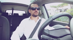 Serious man with white shirt driving car with sun glasses retro style Stock Footage