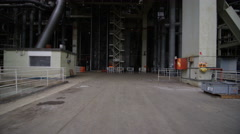 4K Team of engineers in power station, wide shot of workers & building structure Stock Footage