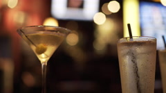 focus on two drinks in a colorfull bar 4k - stock footage