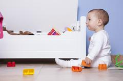 baby boy playing in his toy room - stock photo