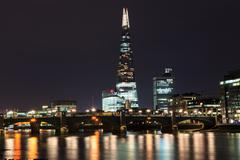 The Shard skyscraper and Thames river at sunset in London, UK Stock Photos