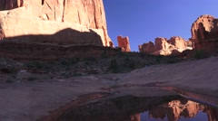 Monoliths reflected in water, ARCHES NATIONAL PARK Stock Footage