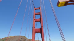 San Francisco Golden Gate Bridge driving low angle moving dolly shot Stock Footage