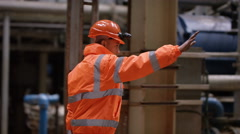 4K Portrait of African American engineer at work in industrial plant Stock Footage