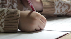 Schoolchild writes a pencil a exercise  book Stock Footage