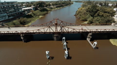 Aerial view of swing bridge on river Stock Footage
