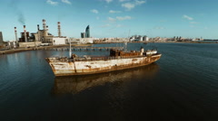 Abandoned ship floating in harbor Stock Footage