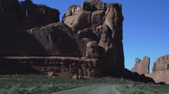 MOTORHOME RV ENTERING ROAD, ARCHES NATIONAL PARK Stock Footage