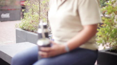 Woman sitting with mate gourd - stock footage
