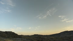 Day to night time lapse over rugged landscape Stock Footage