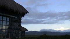 Day to night time lapse of cottage with view of mountains in Ecuador - stock footage