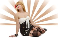 pinup girl sitting on the floor with black stockings - stock photo