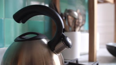 Tea kettle emitting steam - stock footage
