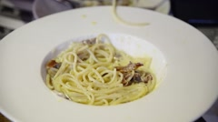 Eating Spaghetti pasta carbonara with twisting fork closeup Stock Footage