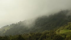 Time lapse of low clouds moving over mountain Stock Footage