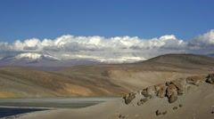 Time lapse of clouds moving over dunes in the Atacama Desert, South America Stock Footage