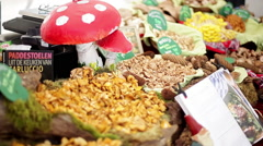 Chanterelles and other varieties of edible mushrooms being sold in market Stock Footage