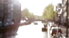 Boat traveling along canal in Amsterdam, Netherlands - stock footage
