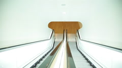 Museum escalator going down to lower level Stock Footage