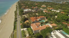 Aerial footage. Flying above Palm Beach,  luxury place for living and vacation Stock Footage