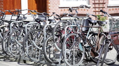 Bicycles parked at public bike rack Stock Footage