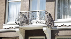 Balcony with wrought iron railing Stock Footage