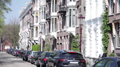 Quiet street lined with stately apartment buildings in Amsterdam, Netherlands Stock Footage