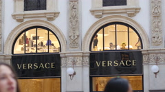 House of Fashion Versace store people shopping Milan Vittorio Emanuele Gallery Stock Footage