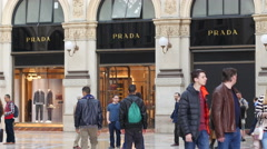 House of Fashion Prada store people shopping in Milan Vittorio Emanuele Gallery Stock Footage