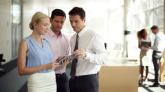 Businesswoman rolling eyes during meeting with associates - stock footage