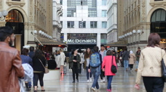 Mc Donalds fast food signboard in Milan Vittorio Emanuele shopping Gallery Stock Footage