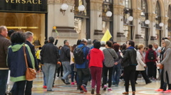 Crowd people tourists group walking in Milan Vittorio Emanuele shopping Gallery Stock Footage