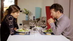 Shy woman having romantic lunch with man at home 4K Stock Footage