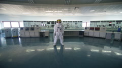 4K Portrait of astronaut standing alone in operations control room Stock Footage