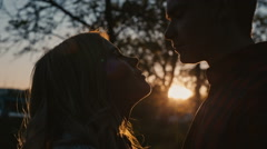 Young romantic couple first kiss Stock Footage